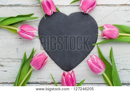 Pink Tulips With An Empty Heart Shaped Chalkboard