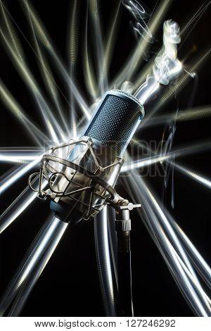 Professional Studio Microphone on black backgroung. light brush