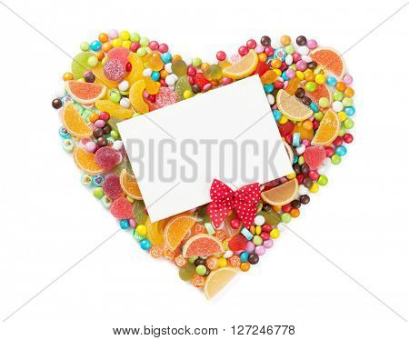 Colorful candies, jelly and marmalade heart with greeting card. Isolated on white background