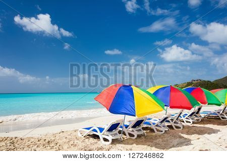 Chairs and umbrellas on a beautiful tropical beach at Caribbean