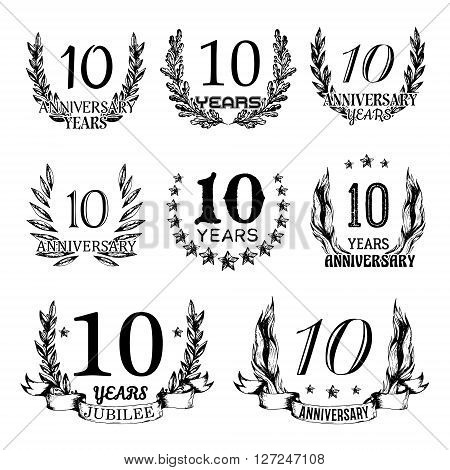 10th anniversary emblems set. Collection of hand drawn anniversary signs with wreath. Celebration badges in sketch style.