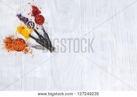 Colorful spices over wooden background. Top view with copy space