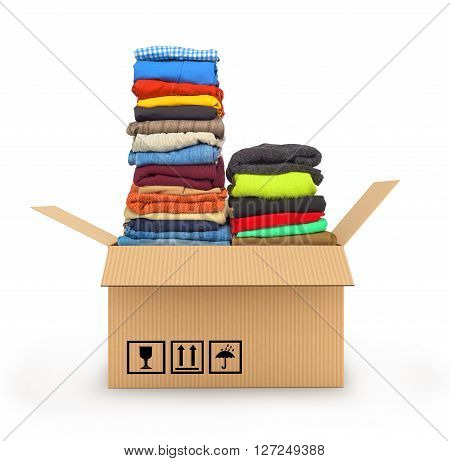 Stack of clothing in cardboard box isolated on white delivery of garments concept
