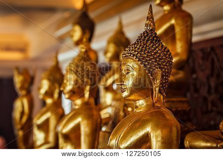 Golden Buddha statues in buddhist temple Wat Saket (The Golden Mount), Bangkok, Thailand
