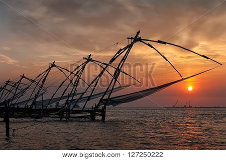 Kerala travel tourist landmark - Kochi chinese fishnets on sunset. Fort Kochin, Kochi, Kerala, India