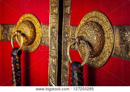Decorated door handles of Kee gompa Tibetan Buddhist monastery. Ki, Spiti valley, Himachal Pradesh, India