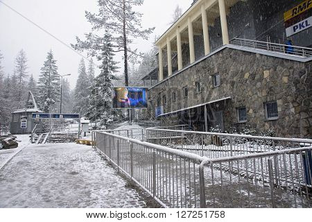 ZAKOPANE POLAND - APRIL 24 2016: Cable car from Zakopane to mount Kasprowy Wierch on 24 April 2016 in Zakopane Poland. Winter view of the lower station of the cableway to mount Kasprowy Wierch - a popular tourist attraction in Zakopane