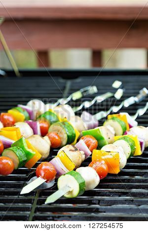 Vegetable and mushrooms kabobs on the grill