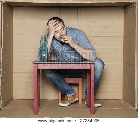 Man Sleeps And Drinks Alcohol