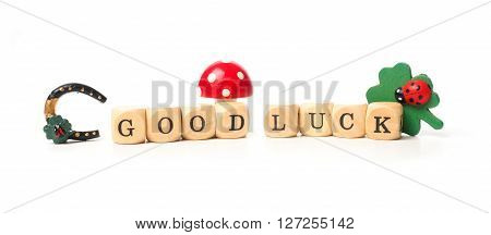 Wooden dices with the words Good luck on a white background