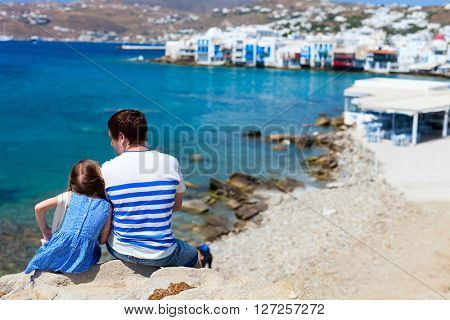Happy family father and his adorable little daughter on vacation at Mykonos island, Greece