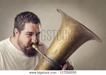 Chubby man playing music
