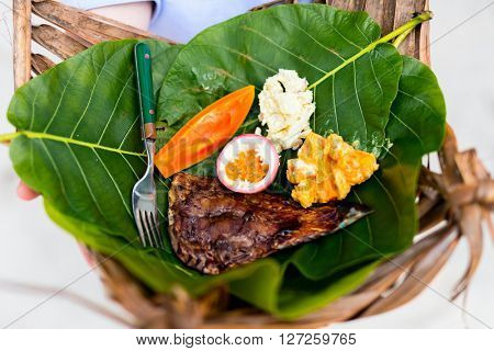 Close up of some local south pacific origin food on a weaved platter