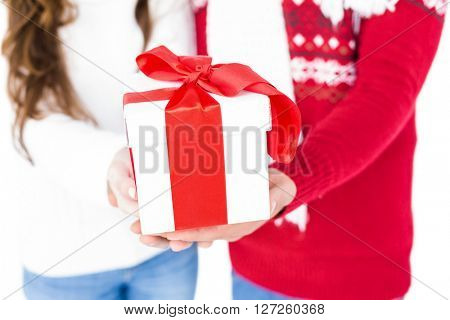 Festive couple holding christmas gift on white screen