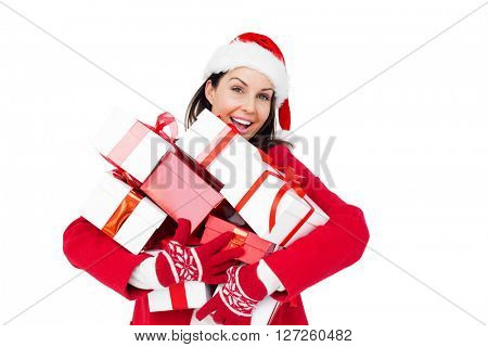 Beautiful brunette with santa hat holding christmas gifts on white background