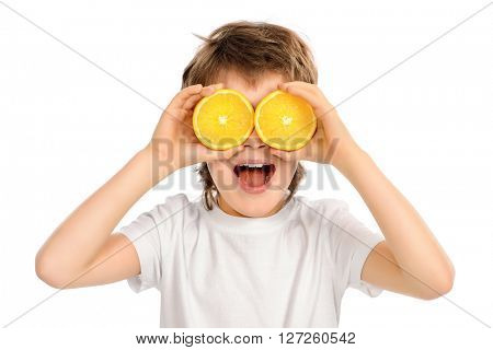 Happy funny boy with fresh oranges. Copy space. Isolated over white.