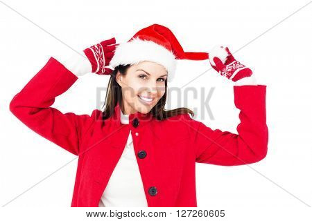 Beautiful brunette holding her santa hat on white background