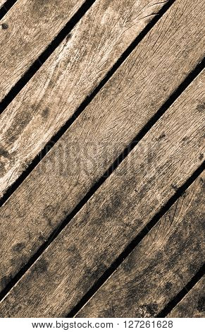 Sepia image of old rustic wooden texture. Vertical concept of real pine old wooden background in brown colors and shades. Vintage rustic wooden texture. Old wooden floor close-up.