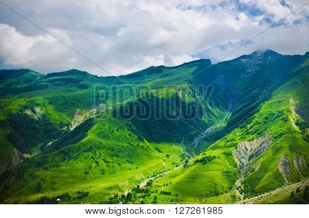 Green caucasus  mountain landscape in Georgia, natural travel vacation background