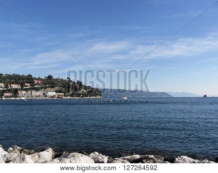 Landscape of Golfo Dei Poeti with its mussel farm in the sea. Province of La Spezia Italy