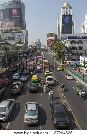 BANGKOK THAILAND - APR 10 : people run across in traffic jam on Ratchadamri road near near CentralWorld on april 10 2016 thailand.