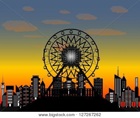 Ferris wheel in the evening time against the backdrop of of the city