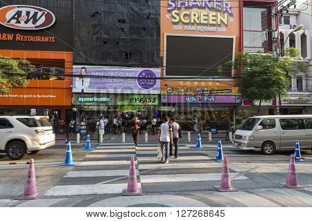 BANGKOK THAILAND - APR 10 : unidentified people walk across crosswalk near Digital Gateway at siam square on april 10 2016 thailand. Siam square is famous shopping place of Bangkok