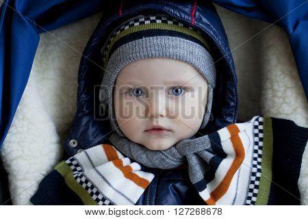 Close up Little boy in stroller in winter