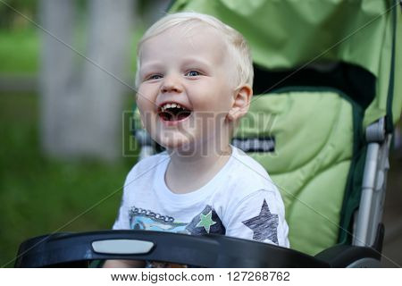 Happy Little boy play in summer park