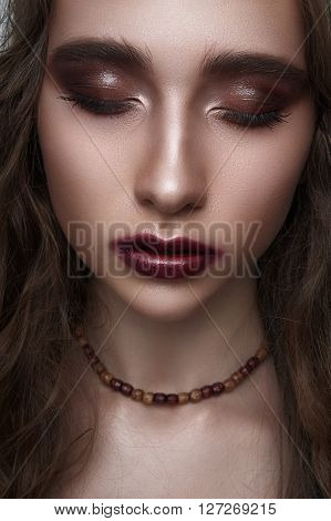 Fashion beauty Girl with closed Eyes and wooden Beads