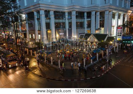 BANGKOKTHAILAND - JAN 23 : dusk scene of unidentified people worship in Erawan shrine at Ratchaprasong Junction on january 23 2016 Thailand.