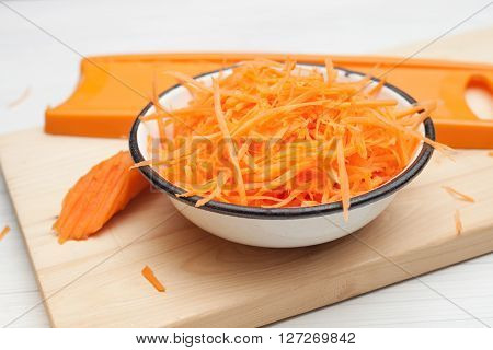 carrot grated carrots on a chopping Board