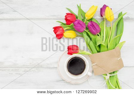 Beautiful tulips with card and coffee for Mothers day