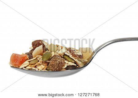Muesli on spoon isolated on white background