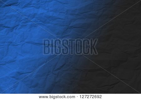 Closeup of a section of crumpled wrapping paper with blue graduated overlay