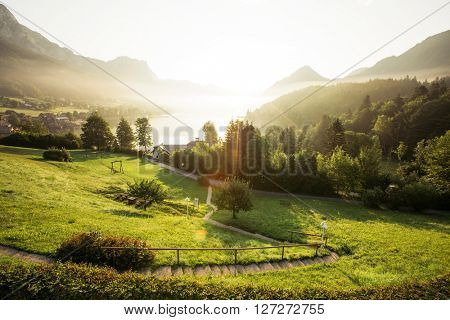 Fantastic views of the morning green garden that glows under sunlight. Dramatic scene. Location: resort Grundlsee, Liezen District of Styria, Austria, Alps. Europe. Beauty world. Instagram effect.