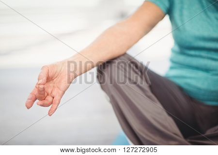 Cropped image of woman performing yoga at home