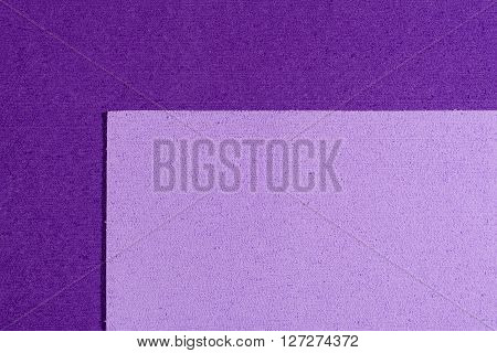 Eva foam ethylene vinyl acetate light purple surface on purple sponge plush background