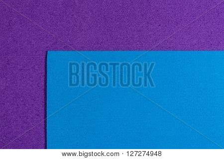 Eva foam ethylene vinyl acetate blue surface on purple sponge plush background