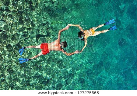 Romantic couple snorkeling in Thailand. Above view