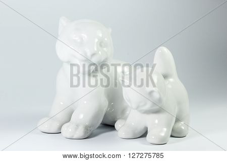 White Porcelain Tigress With Cub On White Background