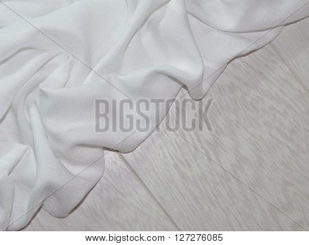 the white cloth laid in the crease lies on wooden boards