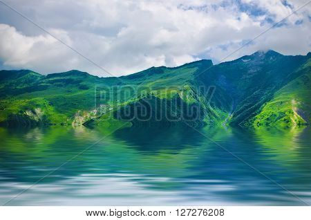 Green caucasus  mountain landscape in Georgia, natural travel vacation background with water reflection