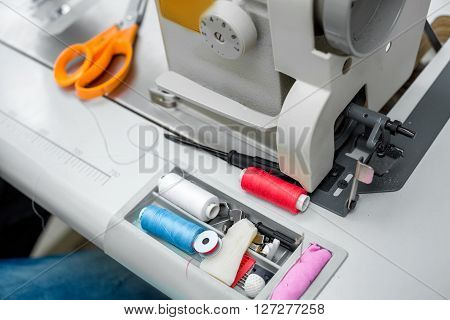 Thread, Scissors And Sewing Machine