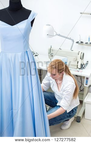 Tailor Ironing The Fabric.