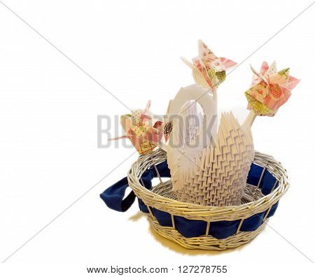 Paper floristry, white swan of the paper modules in the blue basket with three tulips of napkins on white background, there is a place for text