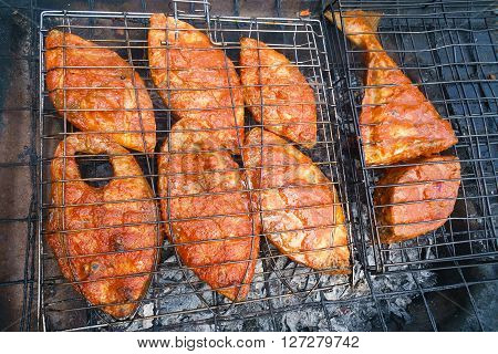 Famous Sabah Malaysian North Borneo grilled fish at street food stall. The fish is marinated wish homemade sweet and hot chili called sambal.