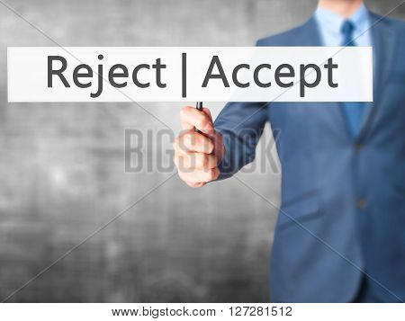 Accept  Reject - Businessman Hand Holding Sign