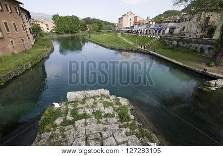 RIETI ITALY - APRIL 16 2016: people along the velino River near the ancient Roman bridge