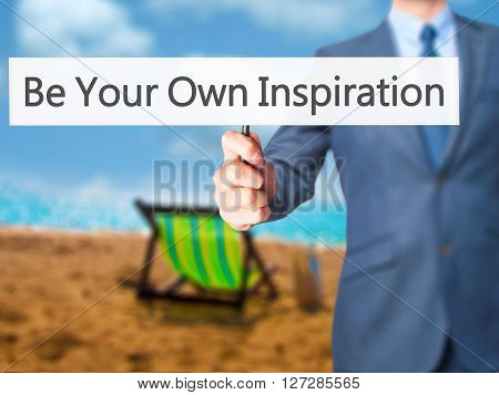 Be Your Own Inspiration - Businessman Hand Holding Sign